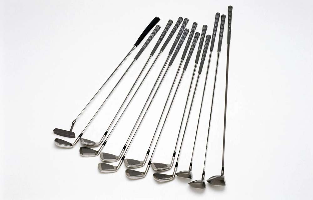 13 different types of golf clubs shown including woods, putter, wedges and irons.