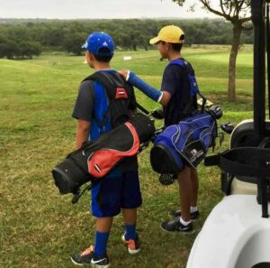 Thomas and Connor playing golf