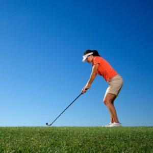 Female golfer hitting a drive