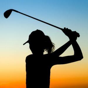 Female golfer driving ball.