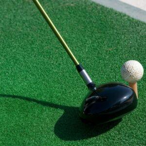 Golf ball being driven