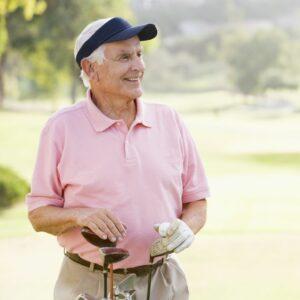 Older golfer in visor