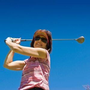 Female golfer driving the ball